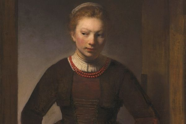 Rembrandt Harmenszoon - Young Woman at an Open Half-Door